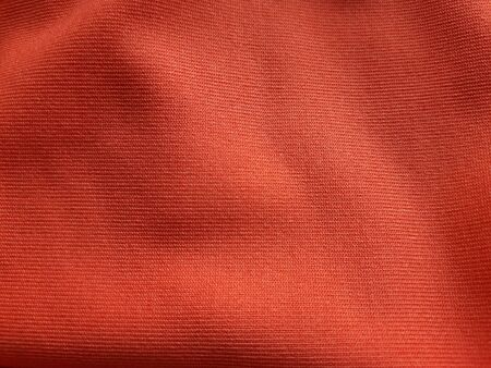 Orange background fabric Swaying like a silk thread when hit by the wind