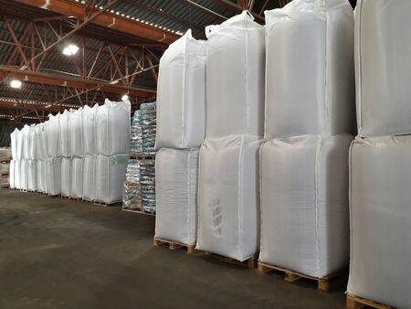 Chemical fertilizer Urea Stock pile jumbo-bag white in warehouse waiting for shipment.