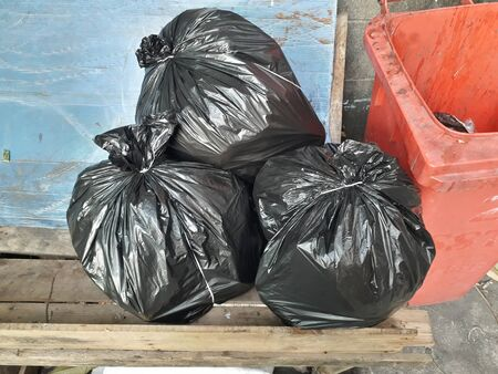 Black garbage bag Ties up the bag for easy storage. Separate the waste before discarding Stock Photo