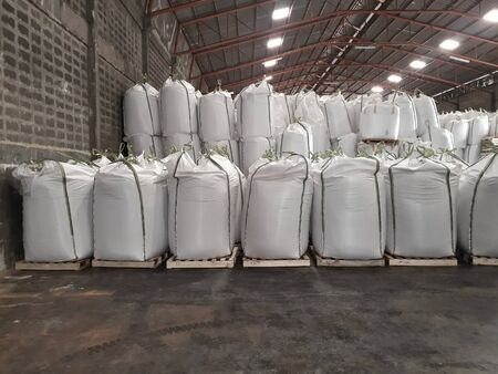 Large jumbo hemp sack White, packed with chemical fertilizer, rice, sugar, placed on a wooden pallet waiting to be delivered to the customer
