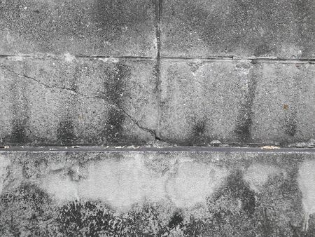 Gray cement wall Broken wall Due to lack of standards causing cracks Stock Photo