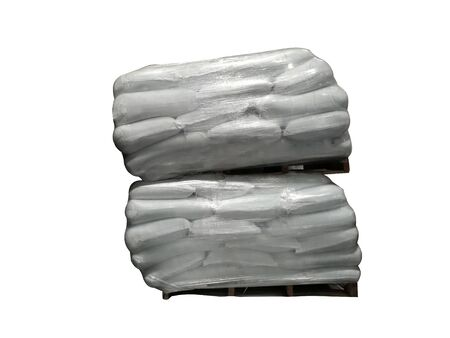 White sack fertilizer Stacked on pallets Wrapped around plastic Waiting for delivery to customers On a white background Stock Photo