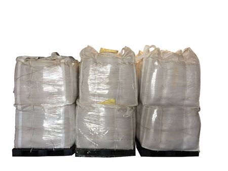 Stock Chemical fertilizer Urea   jumbo-bag in warehouse waiting for shipment.Put on wooden pallets on the White Background Stock Photo