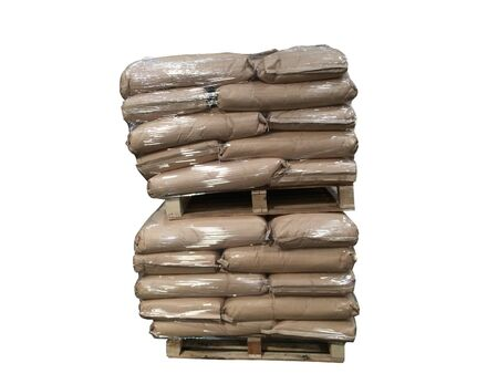 Brown sack fertilizer Stacked on pallets Wrapped around plastic Waiting for delivery to customers On a white background Stock Photo