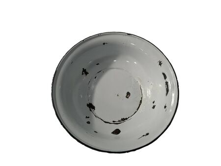 An old white circular bowl placed on a white background
