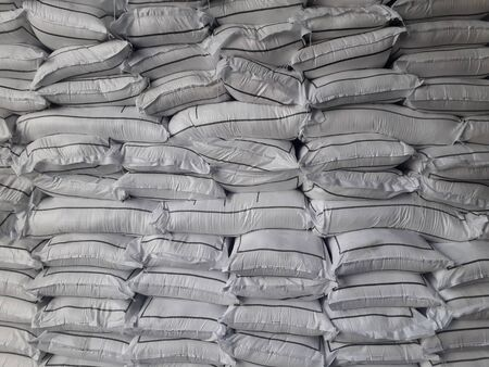 Chemical fertilizer The product stock is packed in sacks, stacked in the warehouse, waiting for delivery. Stock Photo