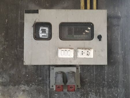 Electrical cabinet  switch is made of plastic as an automatic power-off button light connector on the cement wall For convenient use. Stock Photo