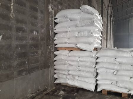 The product stock is packed in sacks, stacked in the warehouse, waiting for delivery.