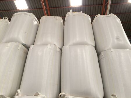 White jumbo sack Large quantities of large quantities of chemical fertilizer sugar rice waiting for delivery to customers.