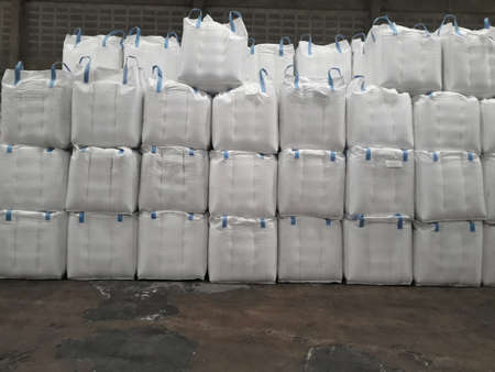 Large jumbo hemp sack White, packed with chemical fertilizer, rice, sugar, placed on a wooden pallet waiting to be delivered to the customer Stock Photo