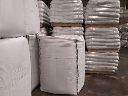 chemical fertilizer Urea Stockpile jumbo-bag in a warehouse waiting for shipment.