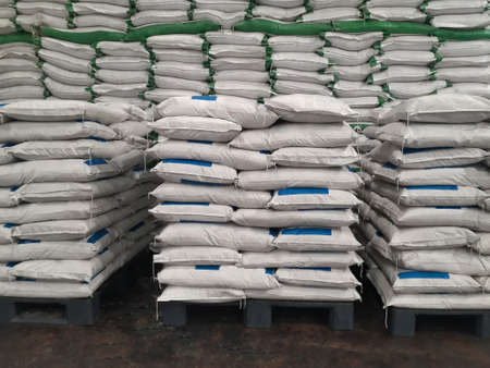 The product Chemical fertilizer is packed in sacks, stacked in the warehouse, waiting for delivery.