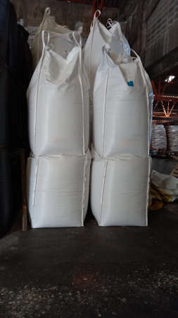 Chemical fertilizer The product stock is packed in sacks, stacked in the warehouse, waiting for delivery. Archivio Fotografico