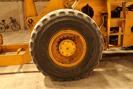 Orange loaders Large old and idle wheels