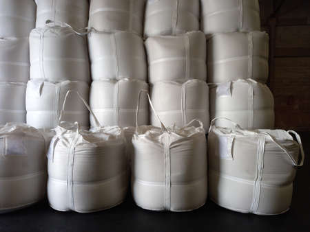 Chemical fertilizer Urea Stockpile white jumbo-bag Large  ammonia nitrate in waiting for shipment is placed in the warehouse. Transport for farmers