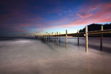 kood: Bridge on beach in sunset and sea wave in Koh Kood , Thailand Stock Photo