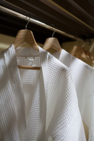 hang body: white robes with wooden hangers