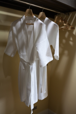 white robes with wooden hangers
