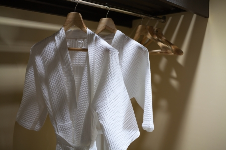 white robes with wooden hangers photo
