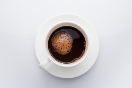 Draufsicht der Kaffeetasse isoliert auf weiß Lizenzfreie Bilder