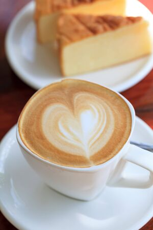 Cup of latte coffee with cake Stock Photo - 22500744