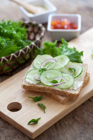multi grain sandwich: Freshly made sanwich on wooden cutting board Stock Photo