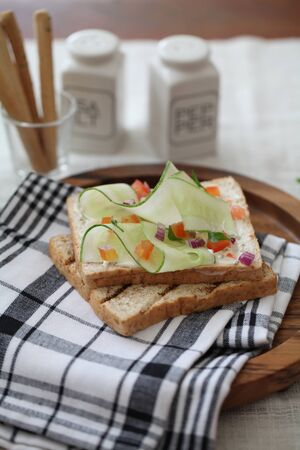 multi grain sandwich: Freshly made sanwich on wooden cutting board Stock Photo