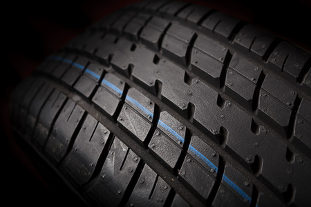 Tire isolated on black background photo
