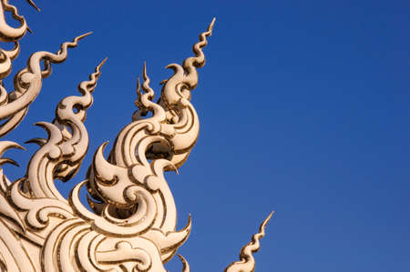 decoration on top of roof at Wat Rong Khun Chiang Rai province Thailand photo