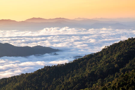 mountains under mist in the morning in Nan ,Thailand photo