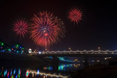 Fireworks over bridge and its reflections on Nan River ,Phitsanulok photo
