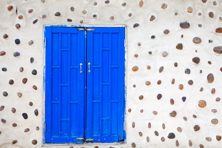 heads old building facade: Blue wooden double door in a stone house