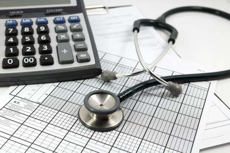 calculator and stethoscope photo