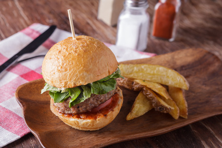 hamburger on wooden plate photo