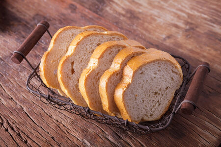sliced bread on wooden background photo