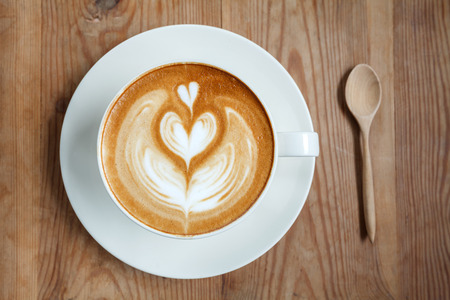 Top view cup of coffee latte with spoon  photo