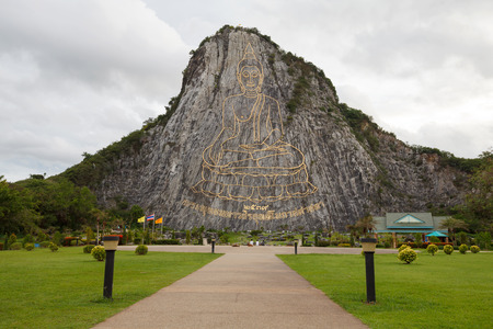 Buddha images the carved on the mountain at Khao Chee Jan, Pattaya, Thailand photo