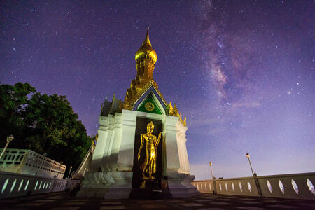 vulpecula: Milky Way at Standing gold Buddha image name is Wat Sra Song Pee Nong in Phitsanulok, Thailand