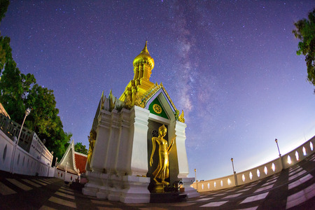 Milky Way at Standing gold Buddha image name is Wat Sra Song Pee Nong in Phitsanulok, Thailand photo