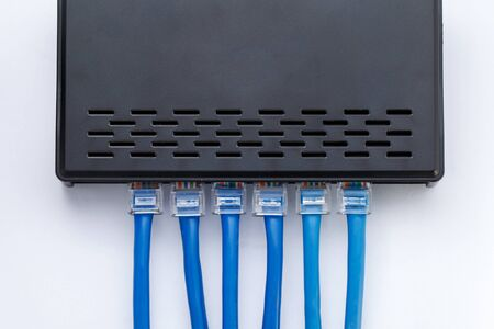 plugged in': LAN network switch with ethernet cables plugged in Stock Photo