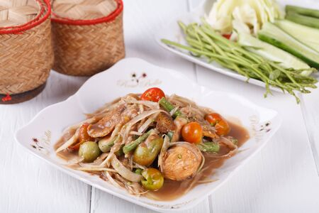 Somtum, papaya salad with pickled fish delicious food in thailand