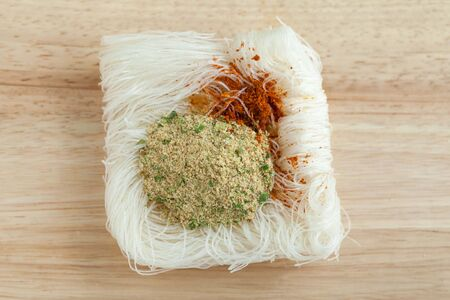 vermicelli: vermicelli noodles on wooden