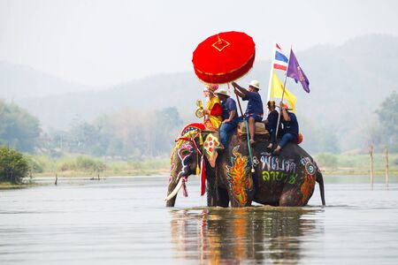 SUKHOTHAI - APRIL 7 : Sukhothai ordination parade on elephant back festival at Hadsiao Temple, Si Satchanalai from April 7 , Riding on elephant and Thai Puan elephant ordination on April 7, 2015 in Sukhothai.