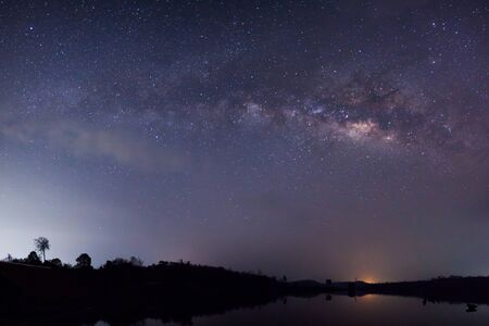Panorama silhouette of Tree with cloud and Milky Way. Long exposure photograph. photo