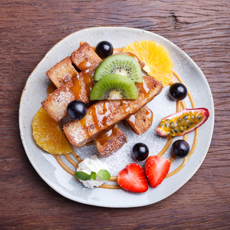 traditionally french: French toast and fresh fruit with caramel sauce