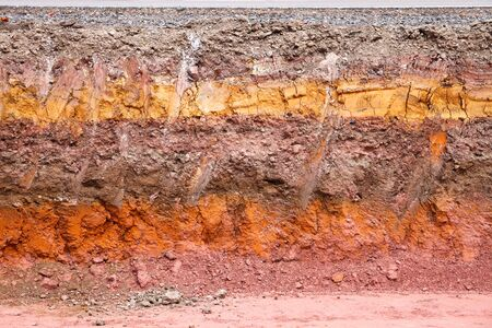 Layer of soil beneath the asphalt road photo