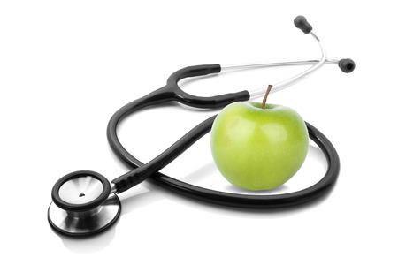 stethescope und Apfel auf weißem Hintergrund Lizenzfreie Bilder