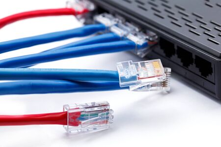 plugged in: LAN network switch with ethernet cables plugged in Stock Photo