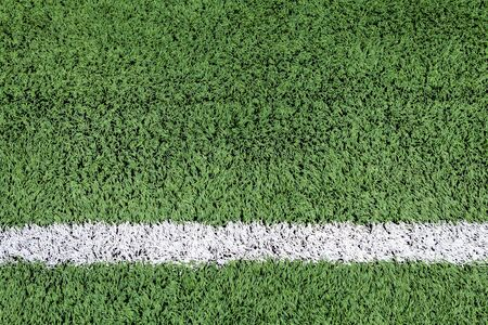 football on the field: White stripe on the green football field