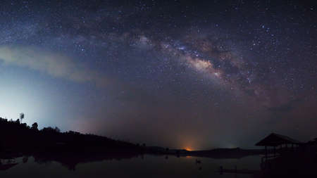 vulpecula: Panorama silhouette of Tree and hut with cloud and Milky Way. Long exposure photograph. Stock Photo